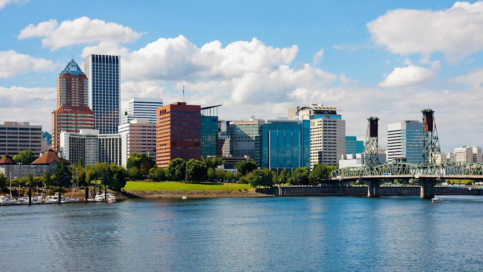 Skyscrapers next to a river in Portland.