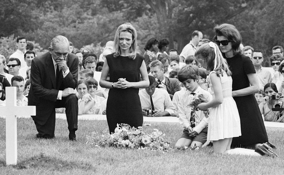<p>Jackie, her children, and the Radziwills visit the grave site of Robert F. Kennedy, her brother-in law, who was assassinated while running for President. </p>
