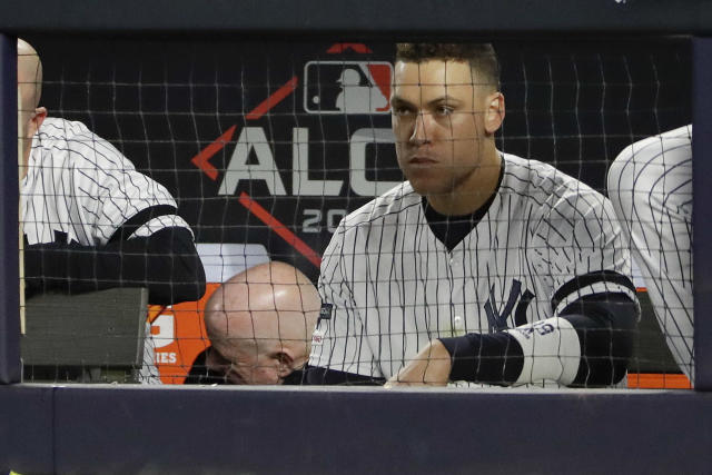New York Yankees right fielder Aaron Judge watches from the dugout during the eighth inning of Game 4 of baseball's American League Championship Series against the Houston Astros, Thursday, Oct. 17, 2019, in New York. (AP Photo/Frank Franklin II)