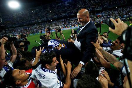 Real Madrid coach Zinedine Zidane is carried by his players as they celebrate winning La Liga.    Reuters / Jon Nazca