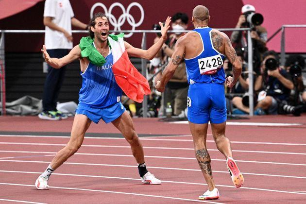 Italy's Lamont Marcell Jacobs (R) celebrates with high jumper Italy's Gianmarco Tamberi after winning the men's 100m final during the Tokyo 2020 Olympic Games at the Olympic Stadium in Tokyo on August 1, 2021. (Photo by Anne-Christine POUJOULAT / AFP) (Photo by ANNE-CHRISTINE POUJOULAT/AFP via Getty Images) (Photo: ANNE-CHRISTINE POUJOULAT via Getty Images)