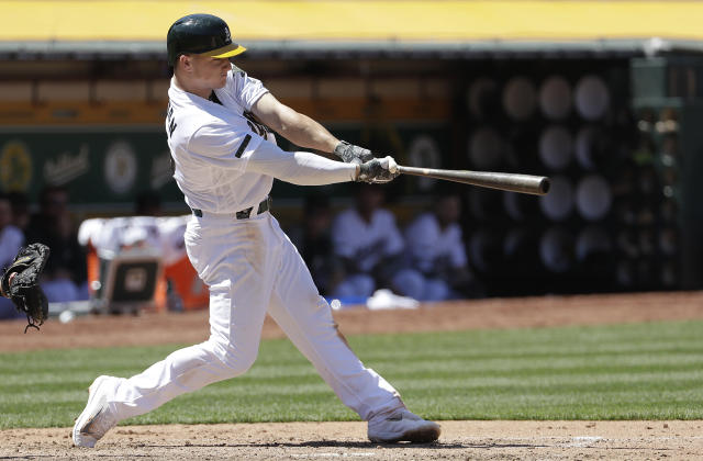 Oakland Athletics' Matt Chapman hits an RBI-single during the sixth inning of a baseball game against the Arizona Diamondbacks in Oakland, Calif., Sunday, May 27, 2018. (AP Photo/Jeff Chiu)