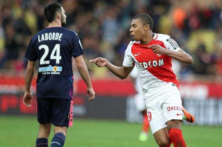 Monaco's Kylian Mbappe (R) celebrates after scoring a goal during their match against Bordeaux (GB) on March 11, 2017 in Monaco