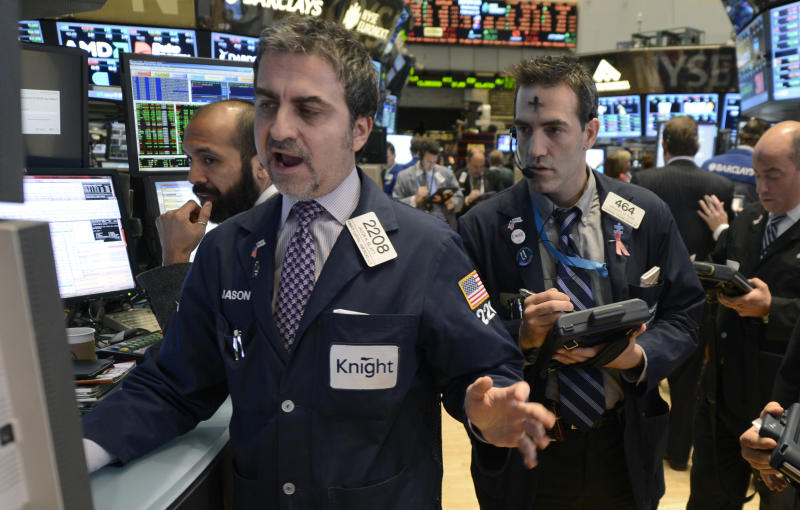 Jason Blatt, left, of Knight Capital and Gregory Rowe of Livermore Trading Group work on the floor of the New York Stock Exchange, Wednesday, Feb. 13, 2013 in New York. (AP Photo/Henny Ray Abrams)