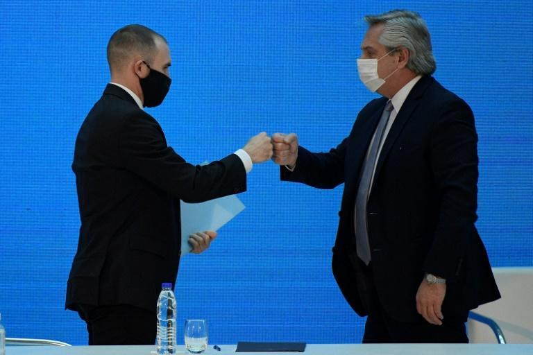 Argentine economy minister Martin Guzman (L) is in isolation after a visiting IMF official tested positive for Covid-19; in a separate case, President Alberto Fernandez (R) has been isolating since Wednesday; they are seen here on August 31, 2020