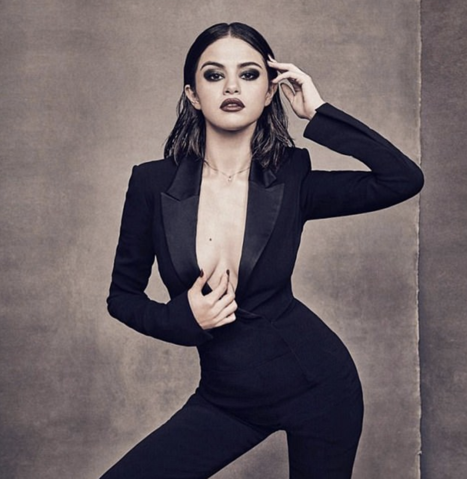"<p>Billboard's Woman Of The Year photoshoot is released, and Selena wears a black <a href=""http://www.fwrd.com/product-crepe-tuxedo-jumpsuit/MUGL-WR14/?utm_medium=affiliate&utm_source=ran&source=ran&utm_campaign=glob_p_TnL5HPStwNw&ranMID=41870&ranEAID=TnL5HPStwNw&ranSiteID=TnL5HPStwNw-DVq0_DMv02t.2aUlnXwXFA&utm_medium=affiliate&utm_source=ran&source=ran&utm_campaign=glob_p_TnL5HPStwNw&ranMID=41870&ranEAID=TnL5HPStwNw&ranSiteID=TnL5HPStwNw-MmJ6Np6xExSdlheLgSqaug"" rel=""nofollow noopener"" target=""_blank"" data-ylk=""slk:Mugler satin trim jumpsuit"" class=""link rapid-noclick-resp"">Mugler satin trim jumpsuit</a>.</p>"