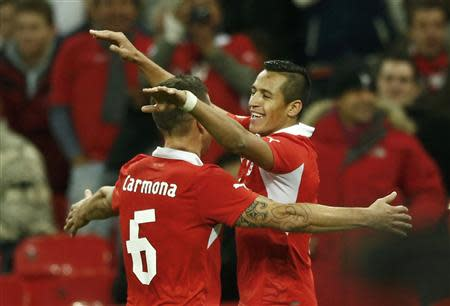 Chile's Alexis Sanchez (R) celebrates a second goal against England's with team mate Carlos Carmona (L) during their international friendly soccer match at Wembley Stadium in London November 15, 2013. REUTERS/Darren Staples