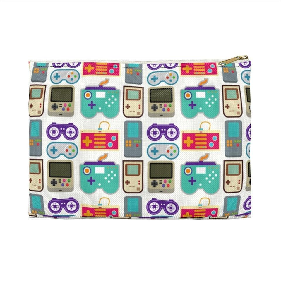 <p>This <span>Retro Gaming Pouch</span> ($16) is an awesome throwback.</p>