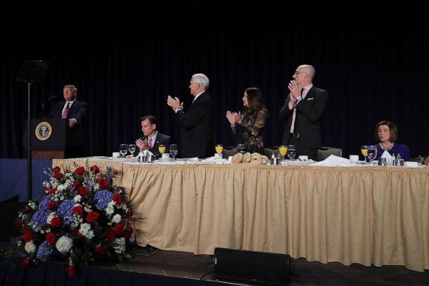 PHOTO: President Donald Trump delivers a speech as Vice President Mike Pence, his wife Karen Pence and House Speaker Nancy Pelosi look on at the National Prayer Breakfast in Washington, Feb. 6, 2020. (Leah Millis/Reuters)