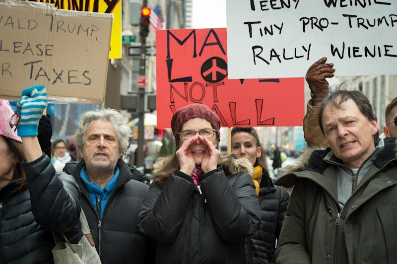 Anti-Trump protesters shout at supporters of US President Donald Trump during a rally near Trump Tower in Fifth Avenue, February 5, 2017 in New York (AFP Photo/Bryan R. Smith)