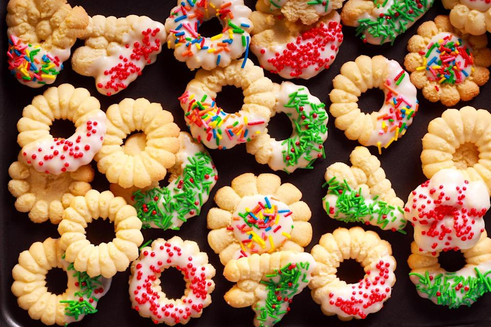 """<p>These small, buttery spritz cookies are on a lot of <a href=""""https://www.thedailymeal.com/holidays/midwestern-christmas-recipes-gallery?referrer=yahoo&category=beauty_food&include_utm=1&utm_medium=referral&utm_source=yahoo&utm_campaign=feed"""" rel=""""nofollow noopener"""" target=""""_blank"""" data-ylk=""""slk:Midwesterner's Christmas dinner tables"""" class=""""link rapid-noclick-resp"""">Midwesterner's Christmas dinner tables</a>, but this simple treat can still be made year-round.</p> <p><a href=""""https://www.thedailymeal.com/recipes/spritz-cookies-recipe?referrer=yahoo&category=beauty_food&include_utm=1&utm_medium=referral&utm_source=yahoo&utm_campaign=feed"""" rel=""""nofollow noopener"""" target=""""_blank"""" data-ylk=""""slk:For the Spritz Cookies recipe, click here."""" class=""""link rapid-noclick-resp"""">For the Spritz Cookies recipe, click here.</a></p>"""