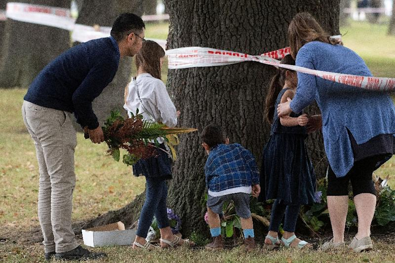 People in Christchurch lay flowers in tribute to those killed in Friday's attack (AFP Photo/Marty MELVILLE)