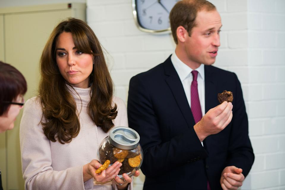 Britain's Catherine, Duchess of Cambridge and Prince William sample some biscuits cooked in the shelter's kitchen during a visit to an accommodation and resettlement centre called 'Jimmy's'  in Cambridge, central England November 28, 2012.  REUTERS/Paul Rogers/Pool    (BRITAIN - Tags: ENTERTAINMENT SOCIETY ROYALS)