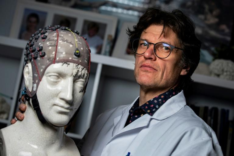 Neurologist Steven Laureys is a pioneer of techniques to allow the formerly comatose to communicate with loved ones (AFP Photo/KENZO TRIBOUILLARD)