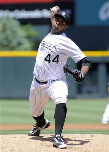 Colorado Rockies starting pitcher Juan Nicasio throws to the Atlanta Braves during the first inning of a baseball game Sunday, May 6, 2012, in Denver. (AP Photo/Jack Dempsey)