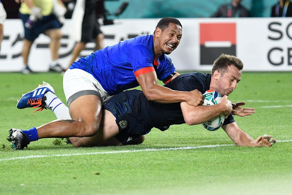 Scotland's scrum-half Greig Laidlaw (R) scores a try during the Japan 2019 Rugby World Cup Pool A match between Scotland and Samoa at the Kobe Misaki Stadium in Kobe on September 30, 2019. (Photo by Filippo MONTEFORTE / AFP)        (Photo credit should read FILIPPO MONTEFORTE/AFP/Getty Images)