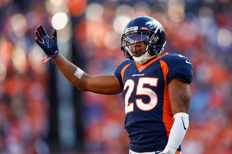 Oct 13, 2019; Denver, CO, USA; Denver Broncos cornerback Chris Harris Jr. (25) motions in the third quarter against the Tennessee Titans at Empower Field at Mile High. Mandatory Credit: Isaiah J. Downing-USA TODAY Sports