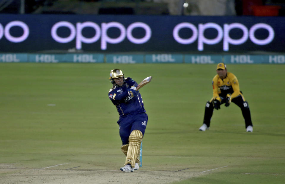 Quetta Gladiators' Azam Khan, center, plays a shot during a Pakistan Super League T20 cricket match between Quetta Gladiators and Peshawar Zalmi at the National Stadium, in Karachi, Pakistan, Friday, Feb. 26, 2021. (AP Photo/Fareed Khan)