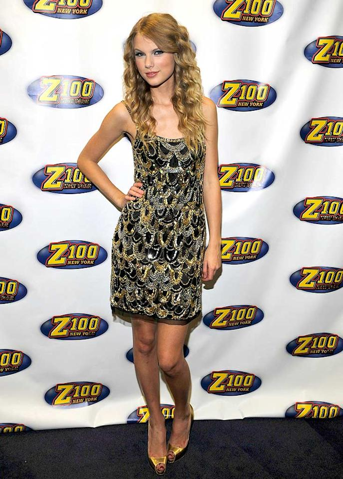 "Newly-minted 20-year-old Taylor Swift rocked a gold and silver beaded Jovani minidress and peep-toe gold pumps at the Z100 Jingle Ball in New York City. Headlining the event, Swift wowed the crowd with her hits that included ""You Belong With Me"" and ""Teardrops On My Guitar."" Kevin Mazur//<a href=""http://www.wireimage.com"" target=""new"">WireImage.com</a> - December 11, 2009"