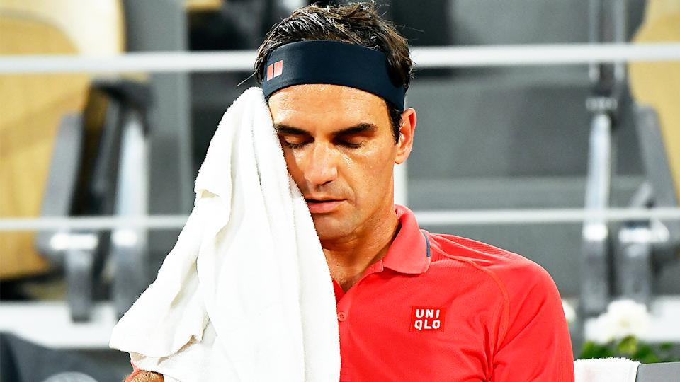 Roger Federer (pictured) looking frustrated and tired during the French Open.
