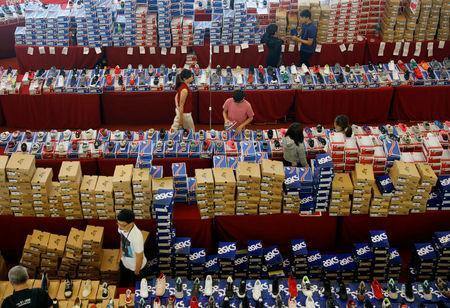 People shop for shoes at a mall in Malaysia's southern city of Johor Bahru April 25, 2017. REUTERS/Edgar Su