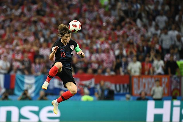 <p>Croatia's midfielder Luka Modric heads the ball during the Russia 2018 World Cup semi-final football match between Croatia and England at the Luzhniki Stadium in Moscow on July 11, 2018. (Photo by FRANCK FIFE / AFP) </p>