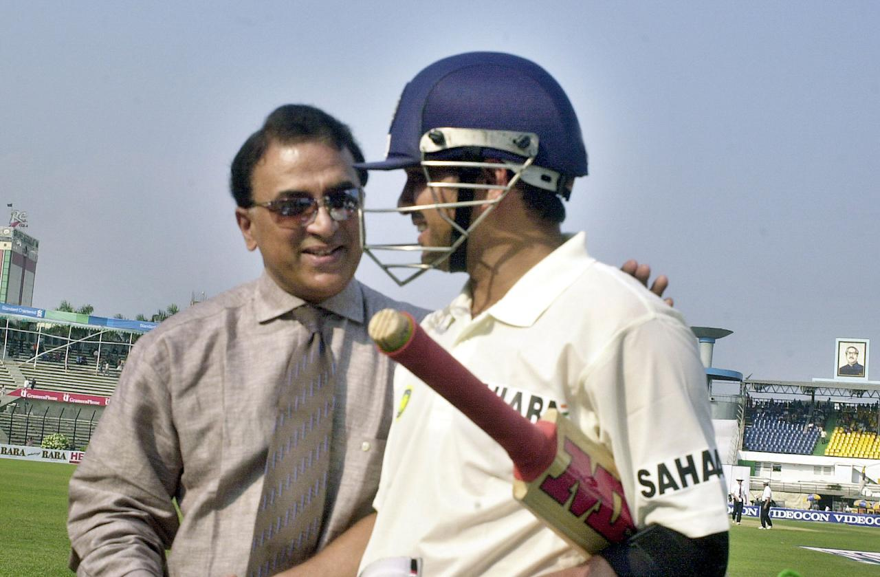 Indian batsman Sachin Tendulkar (R) is congratulated by Sunil Gavaskar after his 34th Test century during the second day of the first Test match between Bangladesh and India at the Bangabandhu National Stadium in Dhaka, 11 December 2004. Tendulkar completed his 34th Test century to catch Sunil Gavaskar's record of world highest Test centurian. Tendulkar hit an unbeaten 169 runs as India scored 348 runs for the loss of seven wickets at the end of day's play. AFP PHOTO/SH. TENKU