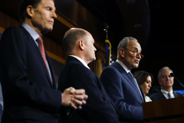 Democratic leader Sen. Chuck Schumer, D-N.Y., talk to reporters about the impeachment trial of President Donald Trump on charges of abuse of power and obstruction of Congress, at the Capitol in Washington, Thursday, Jan. 16, 2020. With Schumer from left is Sen. Richard Blumenthal, D-Conn., Sen. Chris Coons, D-Del., Sen. Kamala Harris, D-Calif., and Sen. Chris Van Hollen, D-Md. (AP Photo/Matt Rourke)