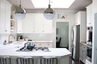 """<p>Fresh, white cabinets, new brass hardware, and some open shelving turned this kitchen into a gorgeous space.</p><p><strong>Get the tutorial at <a href=""""https://www.modern-glam.com/modern-farmhouse-kitchen-reveal/"""" rel=""""nofollow noopener"""" target=""""_blank"""" data-ylk=""""slk:Modern Glam"""" class=""""link rapid-noclick-resp"""">Modern Glam</a>.</strong></p><p><a class=""""link rapid-noclick-resp"""" href=""""https://www.amazon.com/Wine-Cabinet-Handles-Square-Drawer/dp/B0799FB71X/?tag=syn-yahoo-20&ascsubtag=%5Bartid%7C2139.g.34085615%5Bsrc%7Cyahoo-us"""" rel=""""nofollow noopener"""" target=""""_blank"""" data-ylk=""""slk:SHOP BRASS HARDWARE"""">SHOP BRASS HARDWARE</a></p>"""