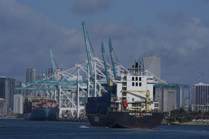 In this April 29, 2021 photo, The Warnow-Dolphin container ship enters PortMiami, in Miami Beach, Fla. Importers are contending with a perfect storm of supply trouble — rising prices, overwhelmed ports, a shortage of ships, trains, trucks — that is expected to last into 2022. (AP Photo/Marta Lavandier)
