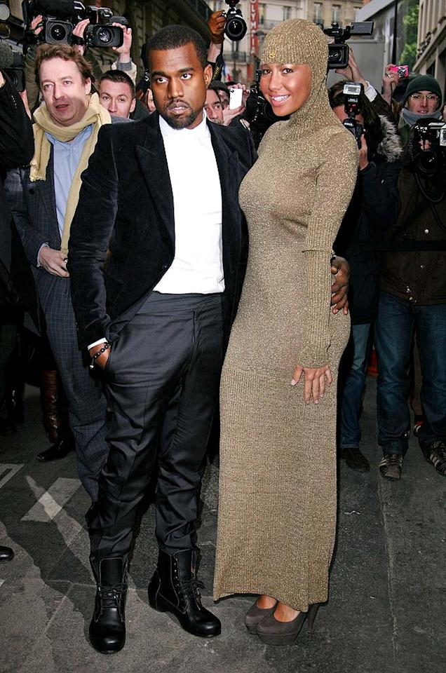 """Attention-seekers Kanye West and Amber Rose continued to embarrass themselves at Paris Fashion Week. The rapper was far from dapper in mismatched fabrics, and his gal pal opted for a medieval garment gone wrong. Julien Hekimian/<a href=""""http://www.wireimage.com"""" target=""""new"""">WireImage.com</a> - January 26, 2010"""
