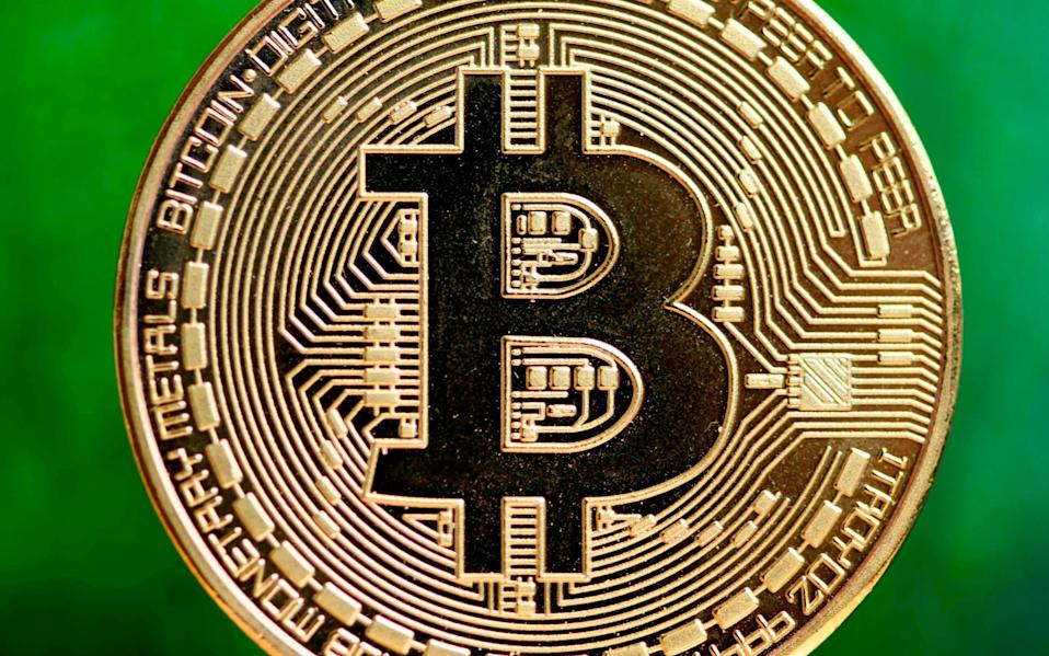 How to add Bitcoin to your Isa and profit tax-free - INA FASSBENDER/AFP
