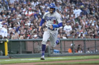 Los Angeles Dodgers' Chris Taylor (3) rounds third base to score a run on a single by Justin Turner against the San Francisco Giants during the third inning of a baseball game Wednesday, July 28, 2021, in San Francisco. (AP Photo/Tony Avelar)