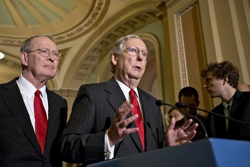 FILE - In this July 9, 2013 file photo, Senate Minority Leader Mitch McConnell of Kentucky. right, accompanied by Sen. Lamar Alexander, R-Tenn., gestures as he speaks with reporters on Capitol in Washington. Republicans see the 2014 midterm elections as a chance to capitalize on voter frustration with the problem-plagued health care overhaul, but the GOP first must settle a slate of Senate primaries where conservatives are arguing over the best way to oppose President Barack Obama's signature law. (AP Photo/J. Scott Applewhite, File)