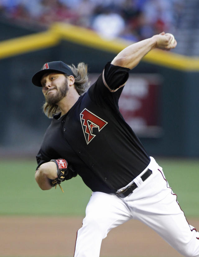 Arizona Diamondbacks' Wade Miley delivers a pitch against the Los Angeles Dodgers during the first inning of a baseball game on Saturday, April 12, 2014, in Phoenix. (AP Photo/Ralph Freso)