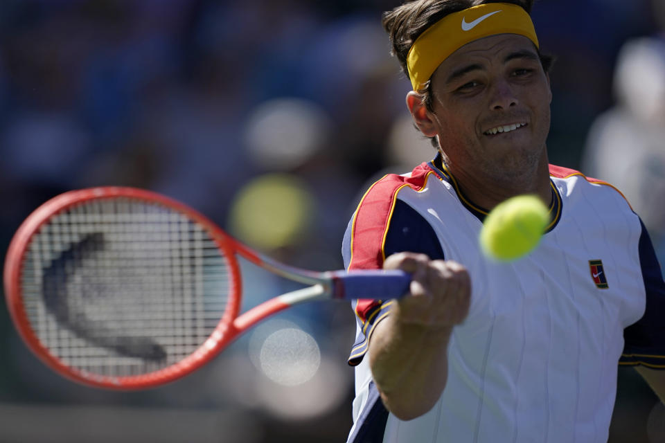 Taylor Fritz returns a shot to Matteo Berrettini, of Italy, at the BNP Paribas Open tennis tournament Tuesday, Oct. 12, 2021, in Indian Wells, Calif. (AP Photo/Mark J. Terrill)