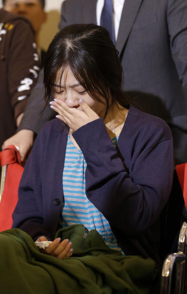 FILE - This July 6, 2013 file photo shows Lee Yunju, a flight attendant of Asiana Flight 214, cries during a news conference at San Francisco International Airport in San Francisco. Before Asiana Flight 214 crash-landed in San Francisco, the last time the Korean airlines' flight attendants made news was over their union's effort earlier this year to get the dress code updated so female attendants could wear trousers. Now, with half of the 12-person cabin crew having suffered injuries in the accident and the remaining attendants receiving praise for displaying heroism during the emergency evacuation, the ill-fated flight is giving a lift to the members of a profession that has worked to be recognized for more than its uniforms and food service skills. (AP Photo/Jeff Chiu, file)