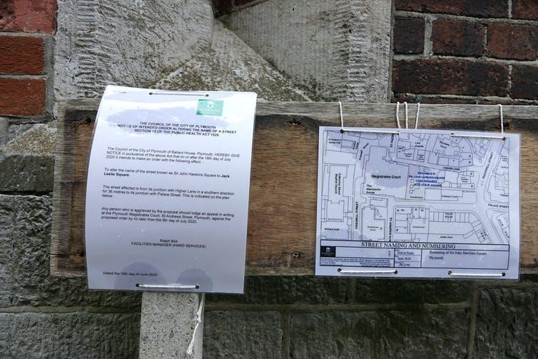 Two signs pinned to a street sign informing the public that the council plans to rename Sir John Hawkins Square.