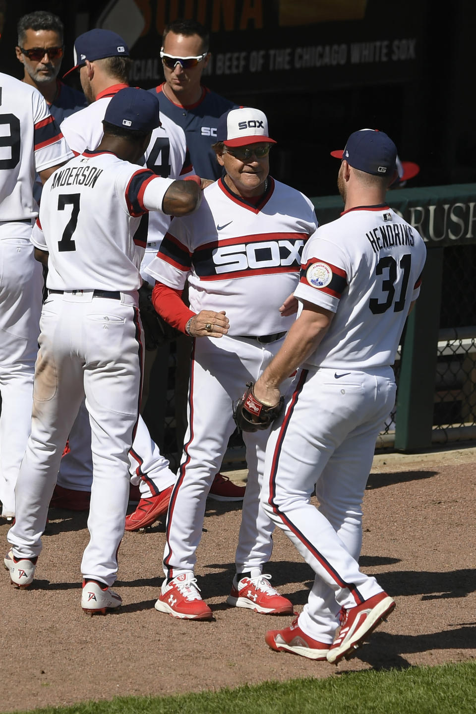 Chicago White Sox manager Tony LaRussa center, celebrates with closing pitcher Liam Hendriks (31) and Tim Anderson (7) after defeating the Baltimore Orioles during a baseball game Sunday, May 30, 2021, in Chicago. (AP Photo/Paul Beaty)