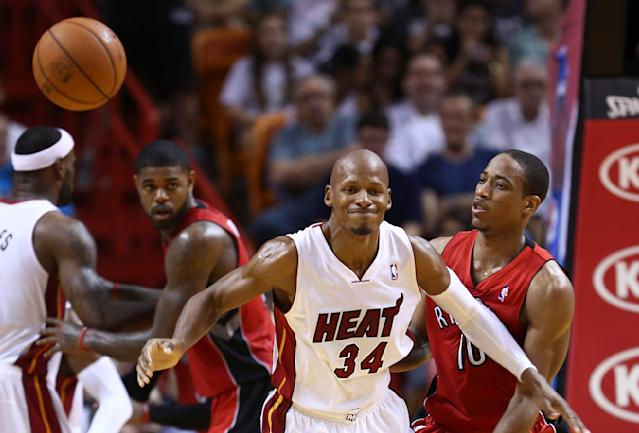 Miami Heat's Ray Allen (34) reacts after Toronto Raptors's DeMar DeRozan (10) knocked the ball from his hands during the second half of a NBA basketball game in Miami, Sunday, Jan. 5, 2014. The Heat won 102-97. (AP Photo/J Pat Carter)