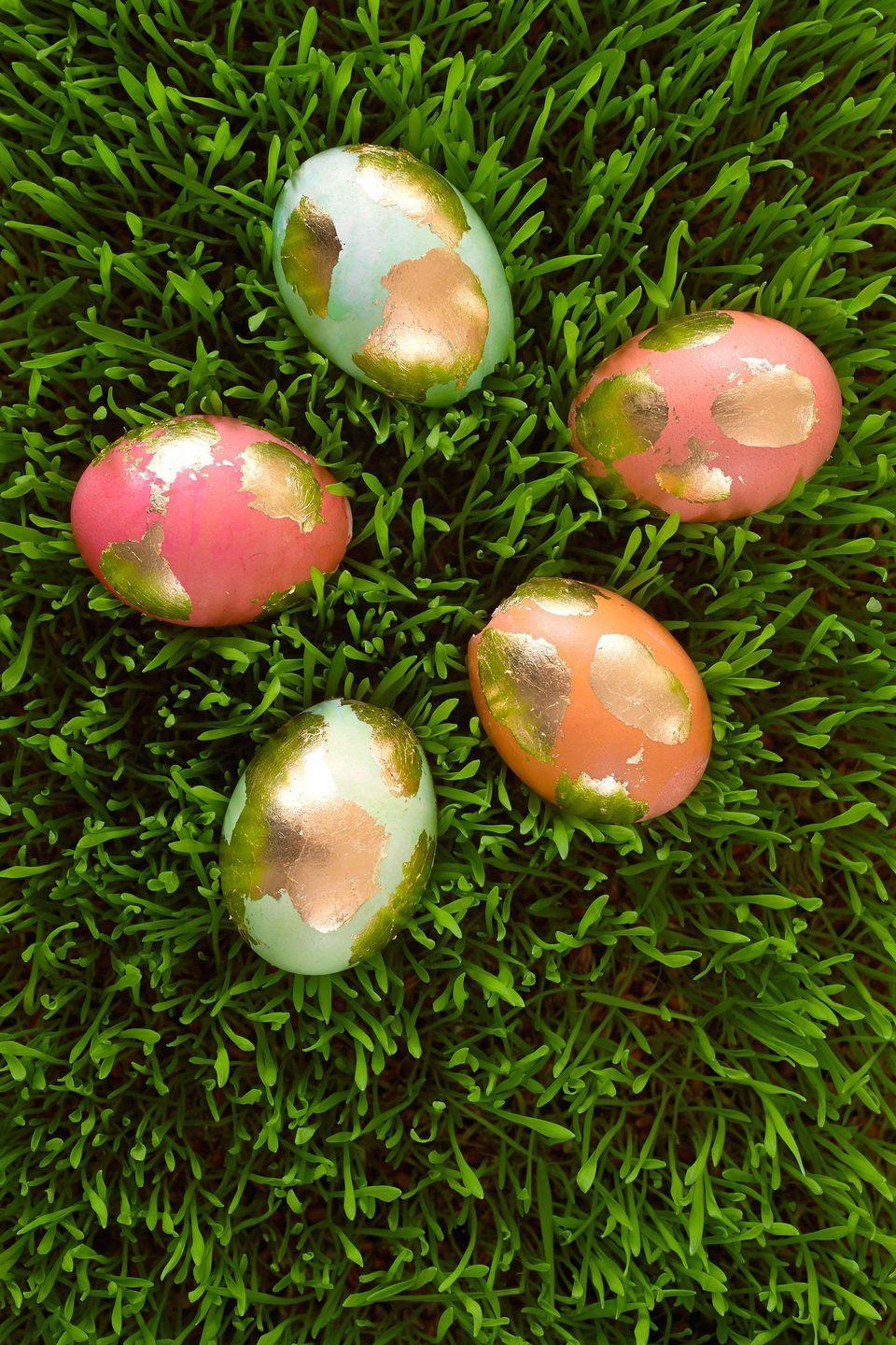 """<p><strong>1.</strong> Dye or paint eggs; let dry completely.</p><p><strong>2.</strong> Use a foam brush to paint abstract splotches of glue from the Mona Lisa Metal Leaf Starter Kit on the eggs; let dry according to package instructions. </p><p><strong>3.</strong> Apply the gold leaf from the kit to the sticky areas (the glue is tacky when it dries) and smooth down with your fingers.</p><p><strong>4.</strong> Use a stiff-bristled brush to sweep away any gold leaf around the egg where there was no adhesive.</p><p><strong><a class=""""link rapid-noclick-resp"""" href=""""https://www.amazon.com/Speedball-Mona-Lisa-Gold-Leaf/dp/B002NQ7RZA/?tag=syn-yahoo-20&ascsubtag=%5Bartid%7C10070.g.1751%5Bsrc%7Cyahoo-us"""" rel=""""nofollow noopener"""" target=""""_blank"""" data-ylk=""""slk:SHOP GOLD LEAF"""">SHOP GOLD LEAF</a></strong></p>"""