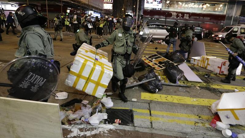 Riot police and protesters have clashed again in another weekend of violence in Hong Kong