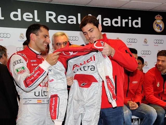 MADRID, SPAIN - NOVEMBER 08: Real Madrid player Iker Casillas (R) and driver Marc Gene attend Real Madrid and Audi event at the Jarama recetrack on November 8, 2012 in Madrid, Spain. (Photo by Fotonoticias/WireImage)