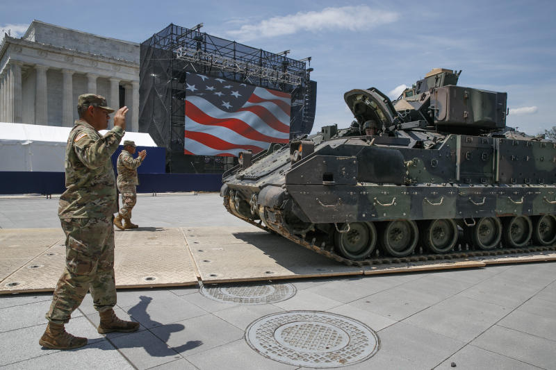 Army soldiers with the 3rd Infantry Division, 1st Battalion, 64th Armored Regiment, move a Bradley Fighting Vehicle into place by the Lincoln Memorial, Wednesday, July 3, 2019, in Washington, ahead of planned Fourth of July festivities with President Donald Trump. (AP Photo/Jacquelyn Martin)