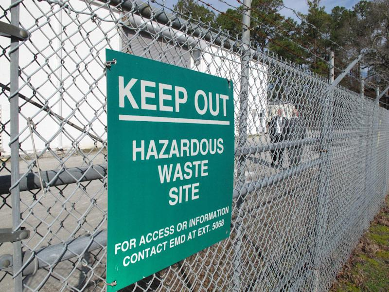 "A sign cautions visitors outside a ""pump and treat"" facility on the Marine base at Camp Lejeune, N.C., on Wednesday, Feb. 27, 2013. The sprawling installation is the site of one of the worst drinking water contaminations in U.S. history. (AP Photo/Allen Breed)"