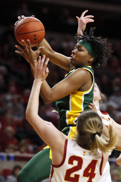 Baylor forward NaLyssa Smith, top, grabs a rebound over Iowa State guard Ashley Joens (24) during the second half of an NCAA college basketball game, Sunday, March 8, 2020, in Ames, Iowa. (AP Photo/Charlie Neibergall)