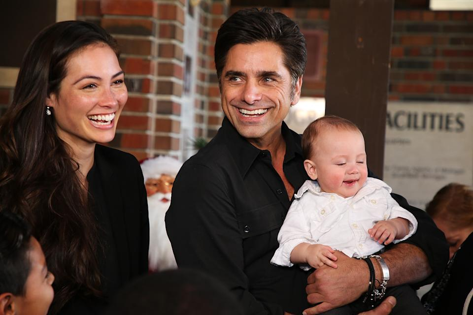 John Stamos, depicted with his wife Caitlin McHugh and their son Billy, was exposed to COVID-19 for the third time. (Photo: Phillip Faraone/Getty Images)