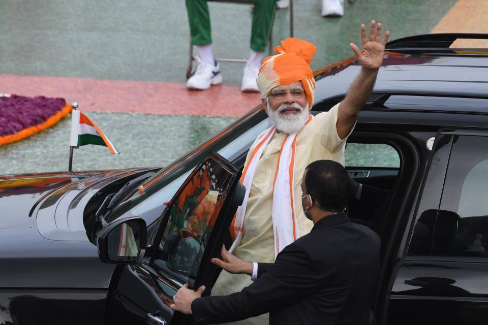 India's Prime Minister Narendra Modi waves as he leaves in a car after his speech to the nation during a ceremony to celebrate India's 74th Independence Day in New Delhi on August 15, 2020. (Photo by PRAKASH SINGH/AFP via Getty Images)