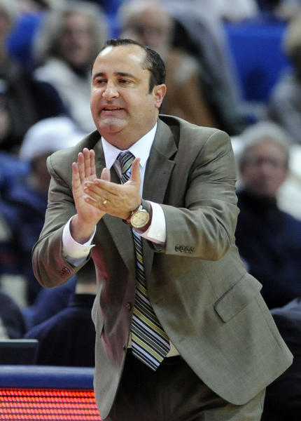 South Florida head coach Jose Fernandez encourages his team during the second half of their 81-53 loss to Connecticut in an NCAA college basketball game in Hartford, Conn., Sunday, Jan. 26, 2014. (AP Photo/Fred Beckham)