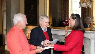 The December 20, 2019 ceremonial swearing-in of LaJuana S. Wilcher of Warren County, Ky. by U.S. Senate Majority Leader Mitch McConnell in his United States Capitol Office. (L to R: Ms. Wilcher's husband Edwin Tivol, U.S. Senate Majority Leader Mitch McConnell, and LaJuana S. Wilcher). Photo provided by the Office of Senator Mitch McConnell for Kentucky.
